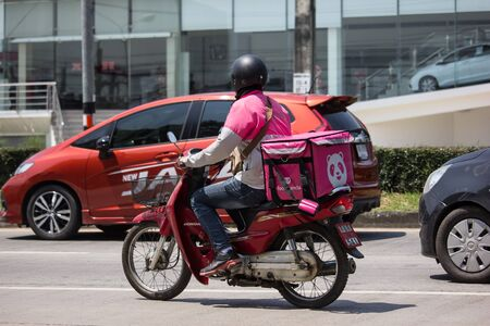 Chiangmai, Thailand - September 27 2019: Delivery service man ride a Motercycle of Food Panda. On road no.1001, 8 km from Chiangmai city.