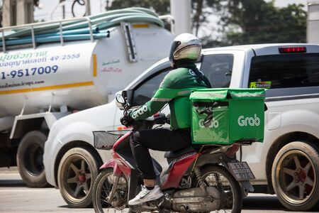 Chiangmai, Thailand -  October 3 2019: Delivery service man ride a Motercycle of Grab Food. On road no.1001, 8 km from Chiangmai city.