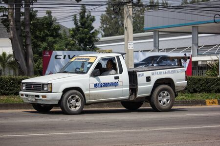 Chiangmai, Thailand -  October 1 2019: Private Tow truck for emergency car move. Photo at road no 121 about 8 km from downtown Chiangmai, thailand. Sajtókép