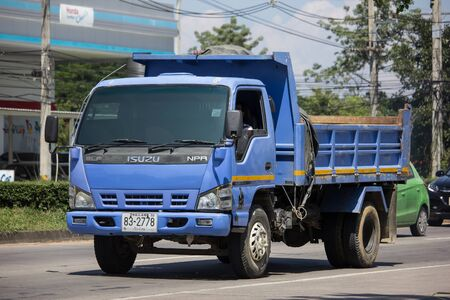 Chiangmai, Thailand -  October 8 2019: Private Isuzu Dump Truck. On road no.1001 8 km from Chiangmai Business Area.