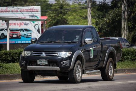 Chiangmai, Thailand -  October 8 2019:  Private car, Mitsubishi Triton Pickup Truck. On road no.1001, 8 km from Chiangmai Business Area. Stock Photo - 133171719