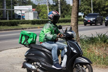 Chiangmai, Thailand - November 27 2019: Delivery service man ride a Motercycle of Grab Food. On road no.1001, 8 km from Chiangmai city. Editorial