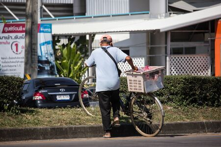 Chiangmai, Thailand - November 21 2019: Private Bicycle with man on Highway Road.   On road no.1001, 8 km from Chiangmai city. Редакционное
