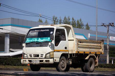 Chiangmai, Thailand - November 28 2019:  Private Isuzu Dump Truck. On road no.1001 8 km from Chiangmai Business Area.