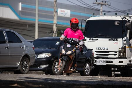 Chiangmai, Thailand - December 2 2019: Delivery service man ride a Motercycle of Food Panda. On road no.1001, 8 km from Chiangmai city.