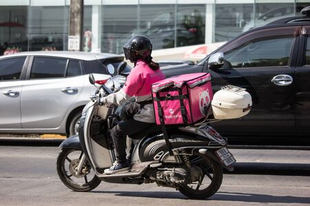 Chiangmai, Thailand - December 6 2019: Delivery service man ride a Motercycle of Food Panda. On road no.1001, 8 km from Chiangmai city.