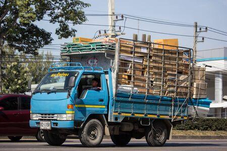 Chiangmai, Thailand - December 2 2019: Toyota DynaTruck of Saha Thip Thong Transport company. On road no.1001, 8 km from Chiangmai city. Reklamní fotografie - 137106974