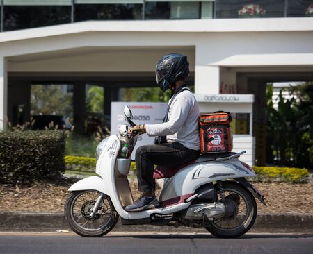 Chiangmai, Thailand - January 17 2020: Delivery service man ride a Motercycle of Pinto Gogo. On road no.1001, 8 km from Chiangmai city. Editorial