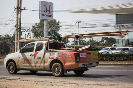 Chiangmai, Thailand - December 12 2019: Pickup truck of Triple T Broadband company. Intenet Service in Thailand. Photo at road no 121 about 8 km from downtown Chiangmai, thailand. Editorial