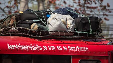 Chiangmai, Thailand - February 7 2020: Bag Cargo on top of  Red taxi chiang mai. On road no.1001 8 km from Chiangmai Business Area.