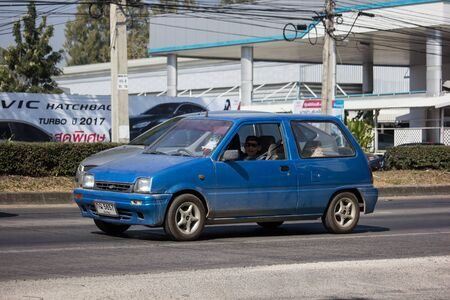 Chiangmai, Thailand - December 16 2019: Private Small city car, Daihatsu Mira. Photo at road no 121 about 8 km from downtown Chiangmai, thailand.