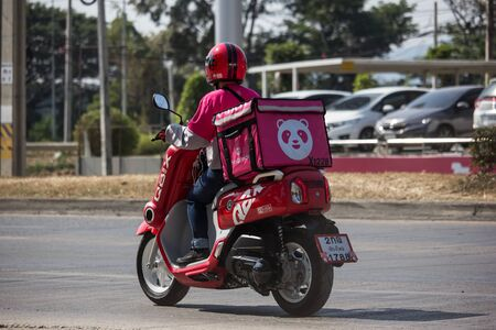 Chiangmai, Thailand - December 24 2019: Delivery service man ride a Motercycle of Food Panda. On road no.1001, 8 km from Chiangmai city. Editorial