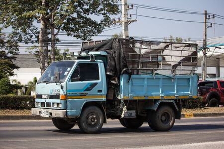 Chiangmai, Thailand - January 7 2020: Private Isuzu Dump Truck. On road no.1001 8 km from Chiangmai Business Area. Editorial