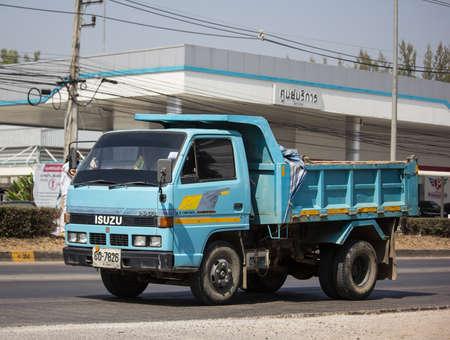 Chiangmai, Thailand - February 7 2020: Private Isuzu Dump Truck. On road no.1001 8 km from Chiangmai Business Area. Editorial