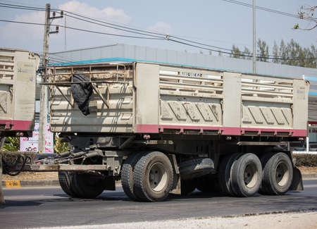 Chiangmai, Thailand - March 6 2020: Trailer Dump truck of Thanachai Company. On road no.1001, 8 km from Chiangmai city.