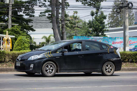 Chiangmai, Thailand -  May 1 2020:  Private car Toyota Prius Hybrid System. On road no.1001 8 km from Chiangmai Business Area.