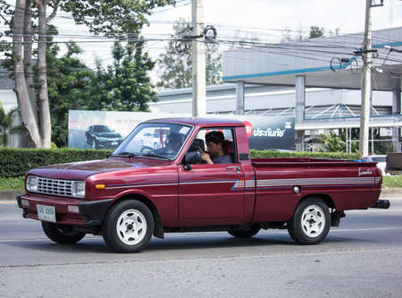 Chiangmai, Thailand -   July 16 2020:  Private car, Mazda Family mini Pick up truck.  On road no.1001, 8 km from Chiangmai Business Area.
