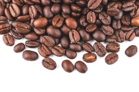 Dark coffee beans placed on a white scene. Stok Fotoğraf