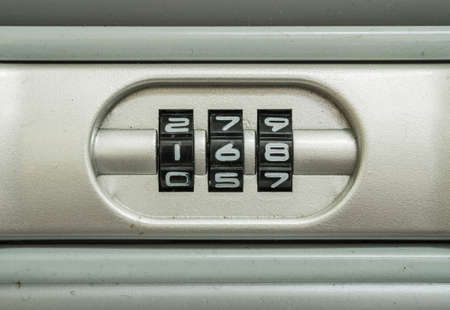 number lock: Closeup code number for lock the old suitcase background Stock Photo