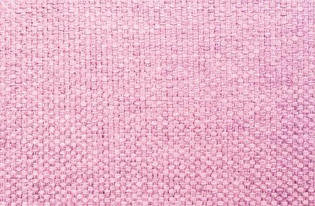 limp: Closeup pink fabric at sofa texture background Stock Photo