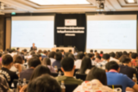 attend: Motion blur of view of seminar with audience in a seminar room Stock Photo
