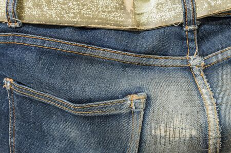 repaired: Closeup at old and repaired jean trousers background Stock Photo