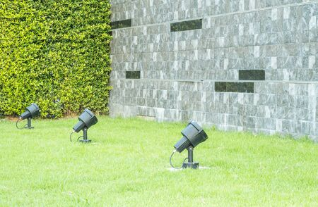 marble wall: Brick marble stone wall with green grass and plant texture background Stock Photo