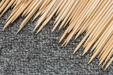 undulatory: Wood stick for meatball skewers with gray carpet texture background