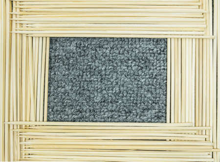 undulatory: Frame of wood stick on gray carpet texture background Stock Photo