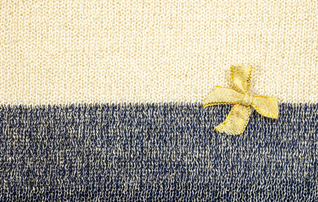 limp: Gold ribbon on two tone fabric texture background
