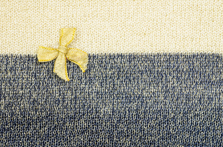 two tone: Gold ribbon on two tone fabric texture background