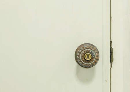 door knob: Closeup old door knob at white door of toilet