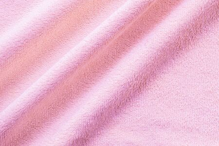 tatter: Closeup wrinkled pink napkin fabric background