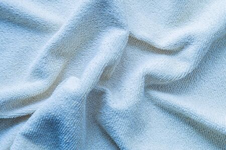 tatter: Closeup wrinkled blue napkin fabric background