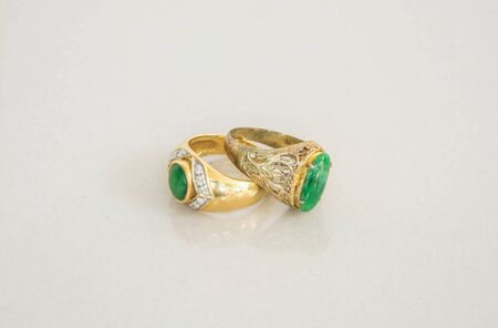 expensive granite: Closeup old green jade rings on blurred marble stone floor texture background