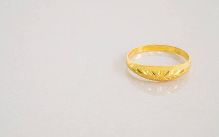 expensive granite: Closeup beautiful golden ring on blurred gray marble stone floor background