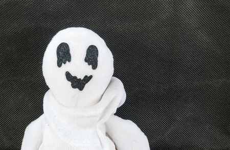cute ghost: cute ghost doll on fabric background Stock Photo