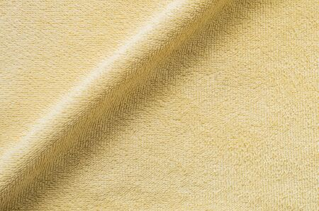tatter: Closeup yellow napkin fabric background