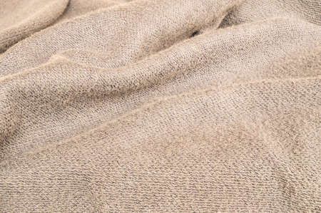 tatter: Closeup wrinkled brown jacket fabric background