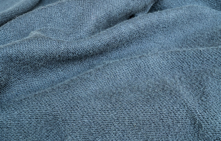 tatter: Closeup wrinkled blue jacket fabric background