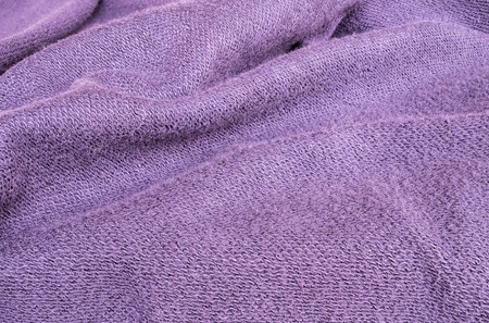 tatter: Closeup wrinkled purple jacket fabric background