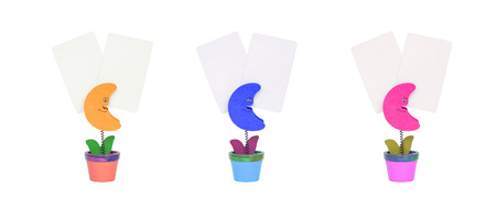 nip: Closeup clamp photo in brown moon , blue moon , pink moon shape in flowerpot with white blank paper isolated on white background
