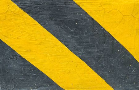 disallow: Closeup surface of old yellow and black painted cement floor texture background sign for let car know this area not allow for parking