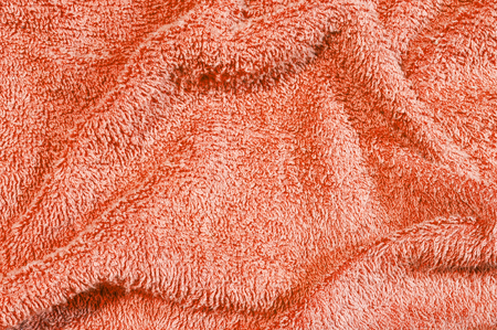 velvety: Closeup surface fabric pattern at old and wrinkled orange fabric towel texture background