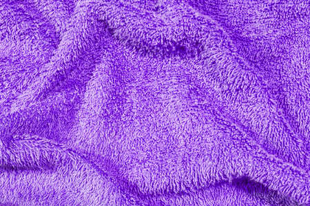 limp: Closeup surface fabric pattern at old and wrinkled purple fabric towel texture background Stock Photo