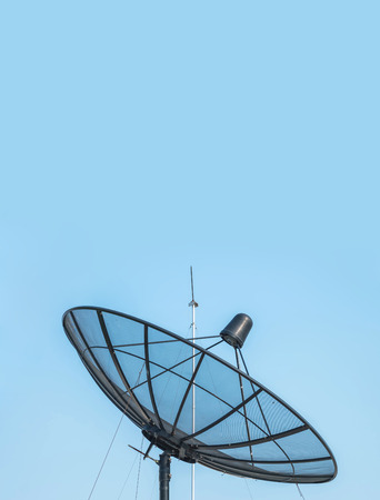 bandwidth: Closeup satellite dish on beautiful clear blue sky textured background with copy space Stock Photo