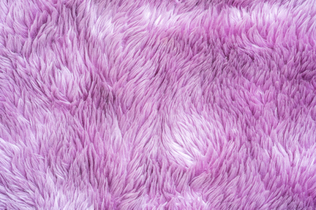 Closeup surface abstract fabric pattern at the purple fabric carpet at the floor of house texture background Stock Photo