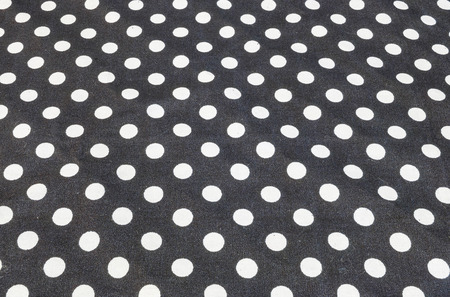 dot surface: Closeup surface fabric pattern at old and wrinkled black fabric handkerchief with white circle dot texture background