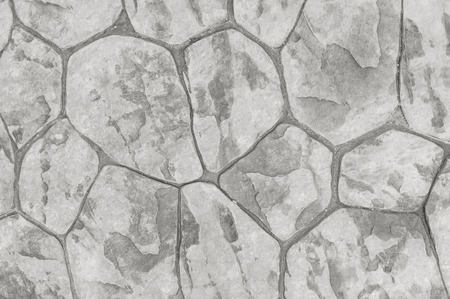 piso piedra: Closeup surface brick pattern at old red stone brick floor at pathway texture background in black and white tone