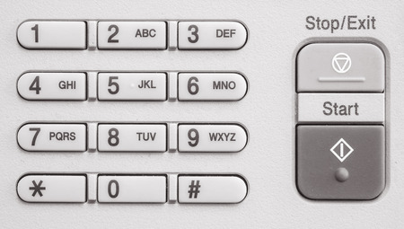 fotocopiadora: Closeup surface number keypad at the old photocopier in the office textured background in black and white tone